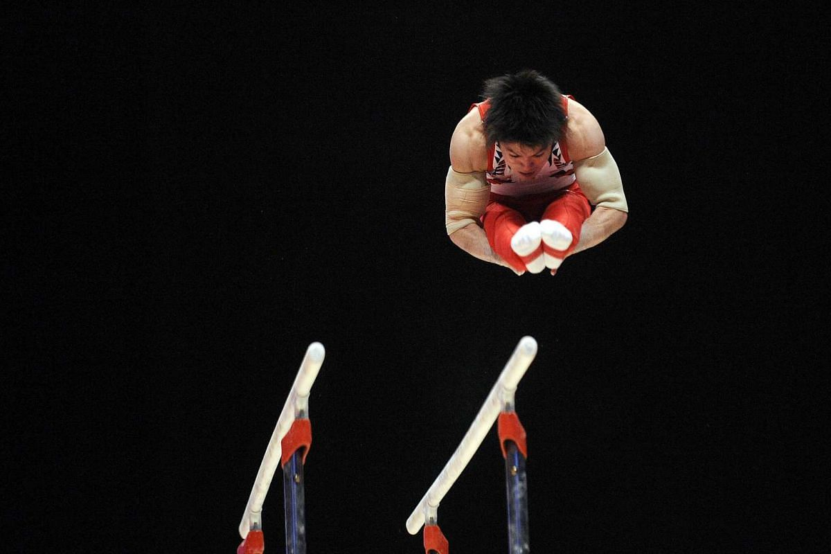Japan's Kohei Uchimura on the parallel bars during the Men's All-Around final during the 2015 World Gymnastics Championship.
