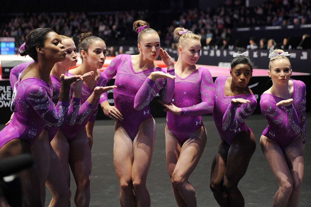 US women's team after competing on the second day of the 2015 World Gymnastics Championships.