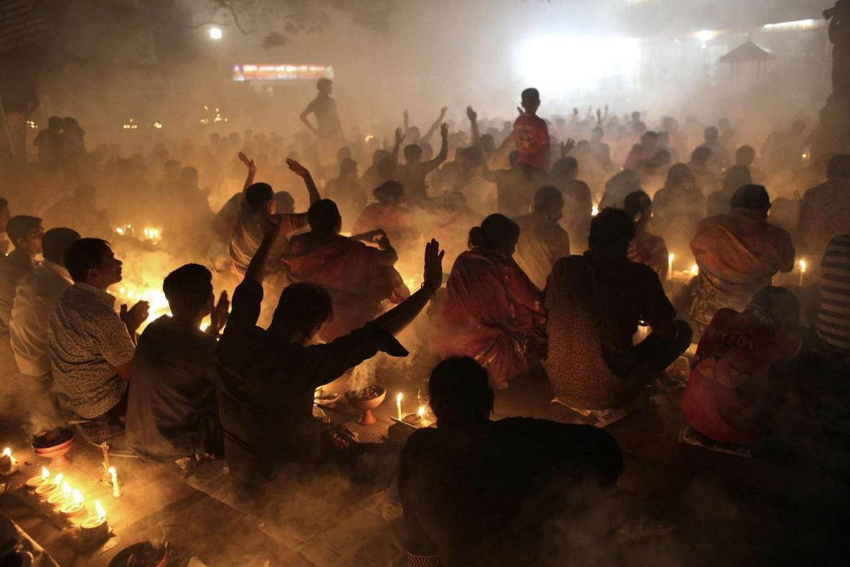 Hindu devotees attending a prayer session before breaking fast during a religious festival called Rakher Upabash in Narayangonj, Bangladesh, on Nov 3, 2015.
