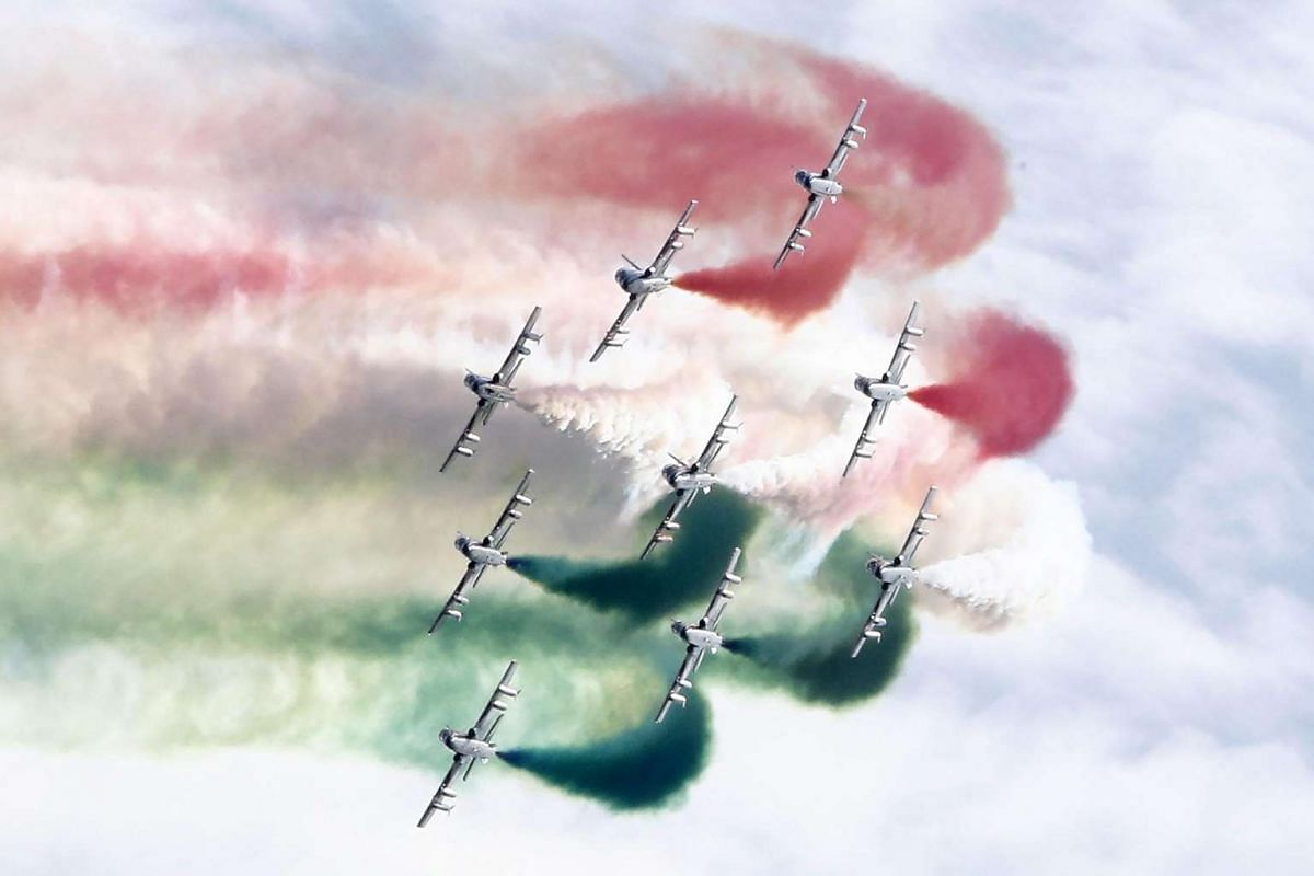 The Frecce Tricolori (Tricolour Arrows), the aerobatic demonstration team of the Italian Air Force, leave a colourful vapour trail as they fly over Rome, on National Army Day, on Nov 4, 2015.