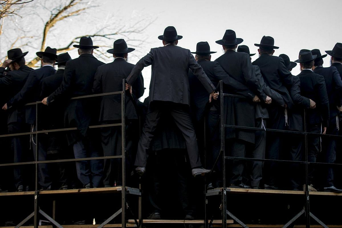 Rabbis posing for a group photo in front of the Chabad-Lubavitch world headquarters in the Brooklyn borough of New York on Nov 8, 2015.