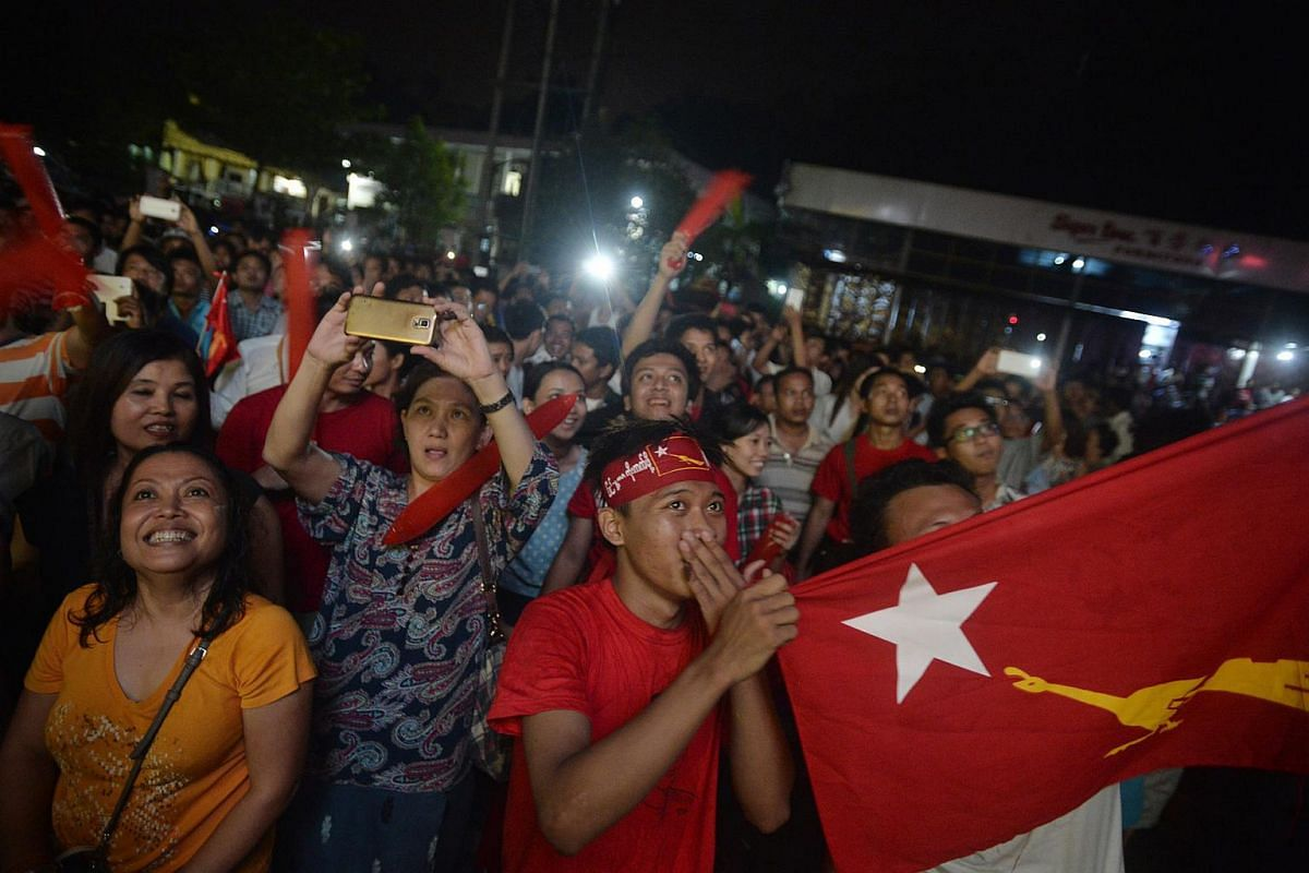 National League for Democracy (NLD) supporters waiting outside the NLD headquarters in Yangon, Myanmar, as the votes for the 2015 General Election are counted on Nov 8, 2015.