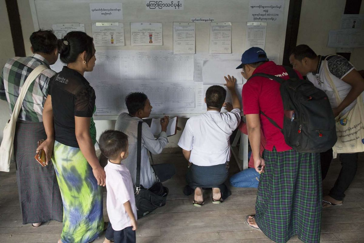 Residents checking vote results at a polling centre in Mandalay on Nov 9, 2015.