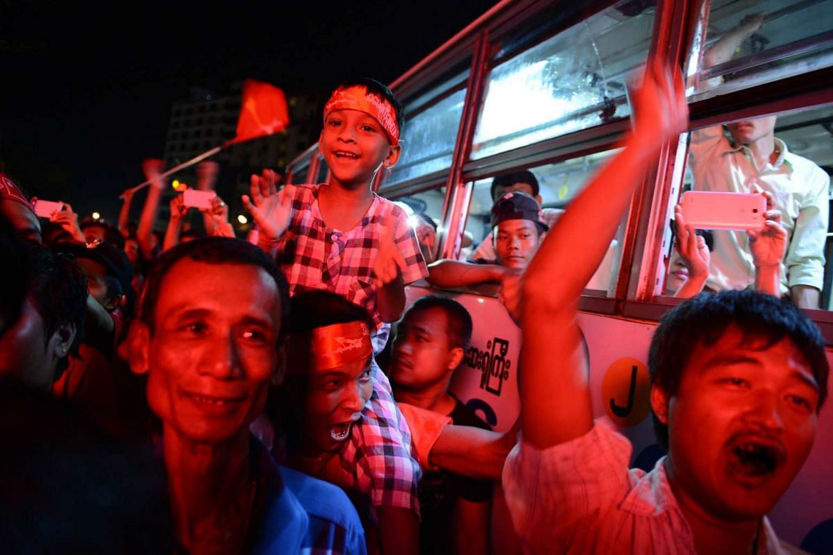 Supporters of Aung San Suu Kyi's National League for Democracy celebrating as they gather outside the NLD headquarters in Yangon on Nov 9, 2015.