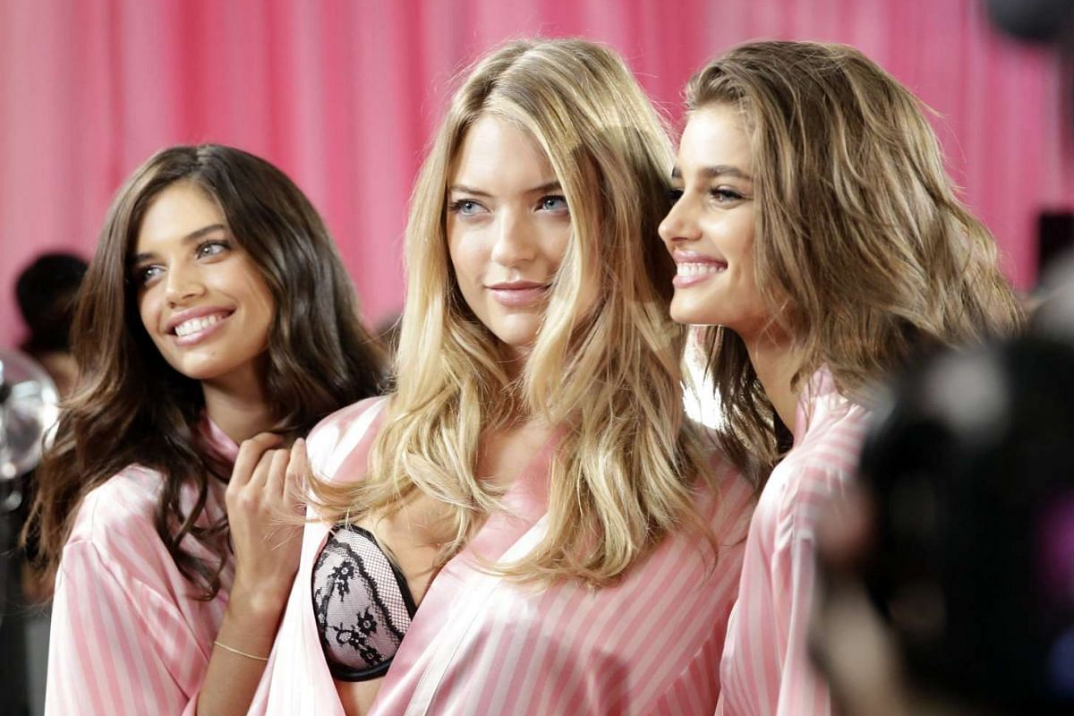 Victoria's Secret models (from left) Sara Sampaio from Portugal, Martha Hunt and Taylor Hill from the United States posing backstage during hair and make-up before the 2015 Victoria's Secret fashion show at the Lexington Armory in New York on Nov 10,