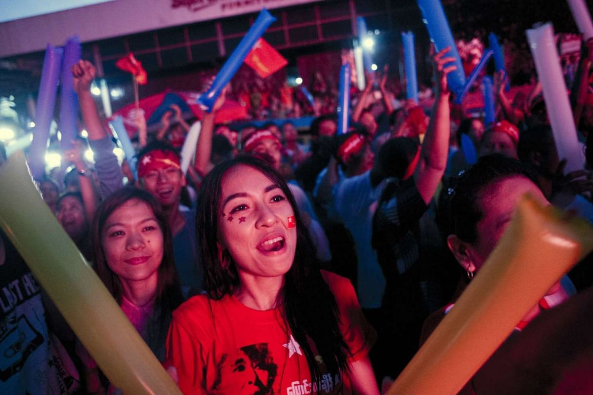 Supporters of Myanmar opposition leader Aung San Suu Kyi celebrating as they look at the official election results on a giant screen outside the National League of Democracy headquarters in Yangon on Nov 9, 2015.