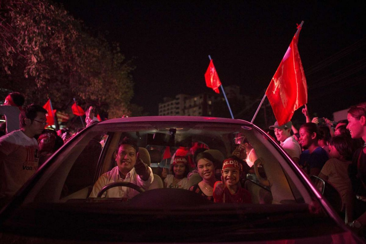 Supporters of Myanmar opposition leader Aung San Suu Kyi celebrating outside the National League of Democracy headquarters in Yangon on Nov 9, 2015.