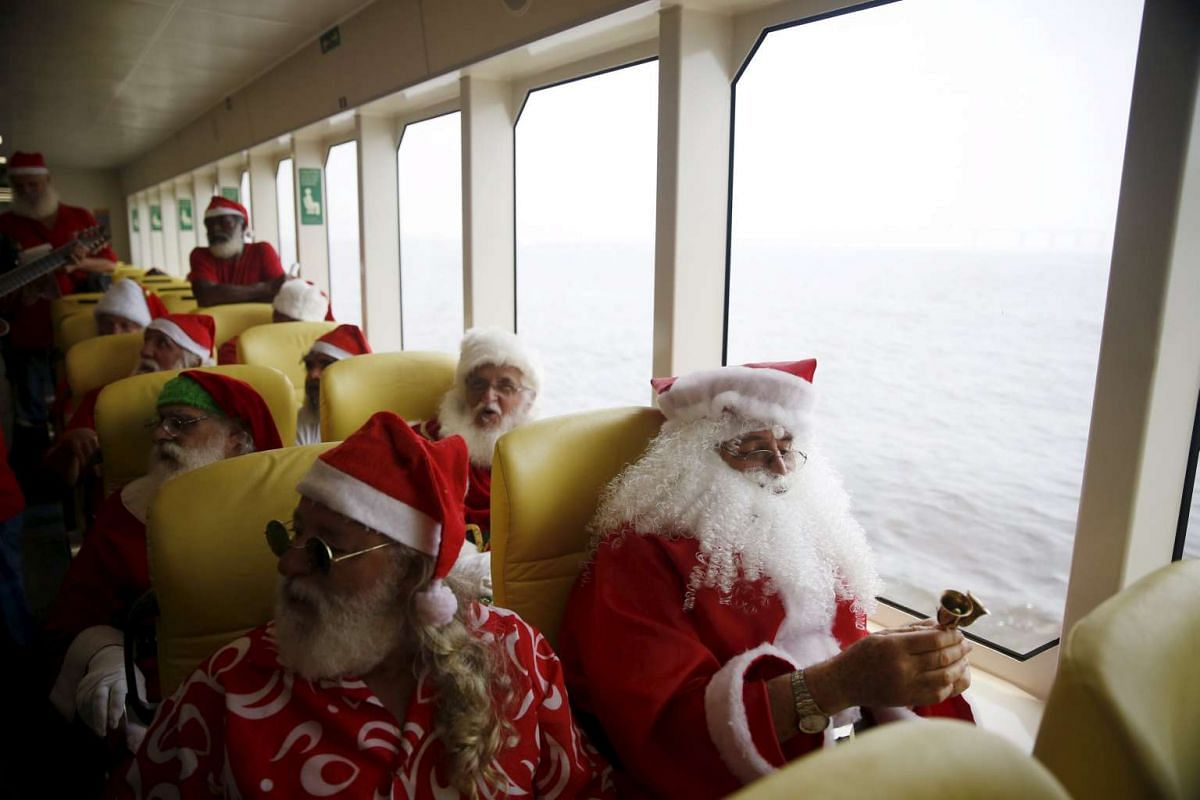 Students of the Escola de Papai Noel do Brasil (Brazil's School of Santa Claus) travelling on a ferry through Guanabara bay during their graduation ceremony in Rio de Janeiro on Nov 10, 2015.