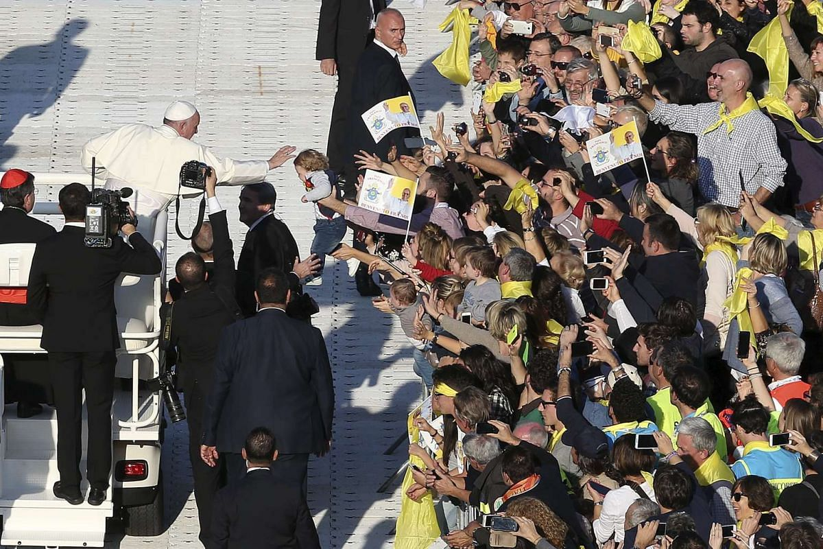 Pope Francis blessing a baby as he arrives to celebrate a mass at the Artemio Franchi stadium during his pastoral visit in Florence, Italy, on Nov 10, 2015.