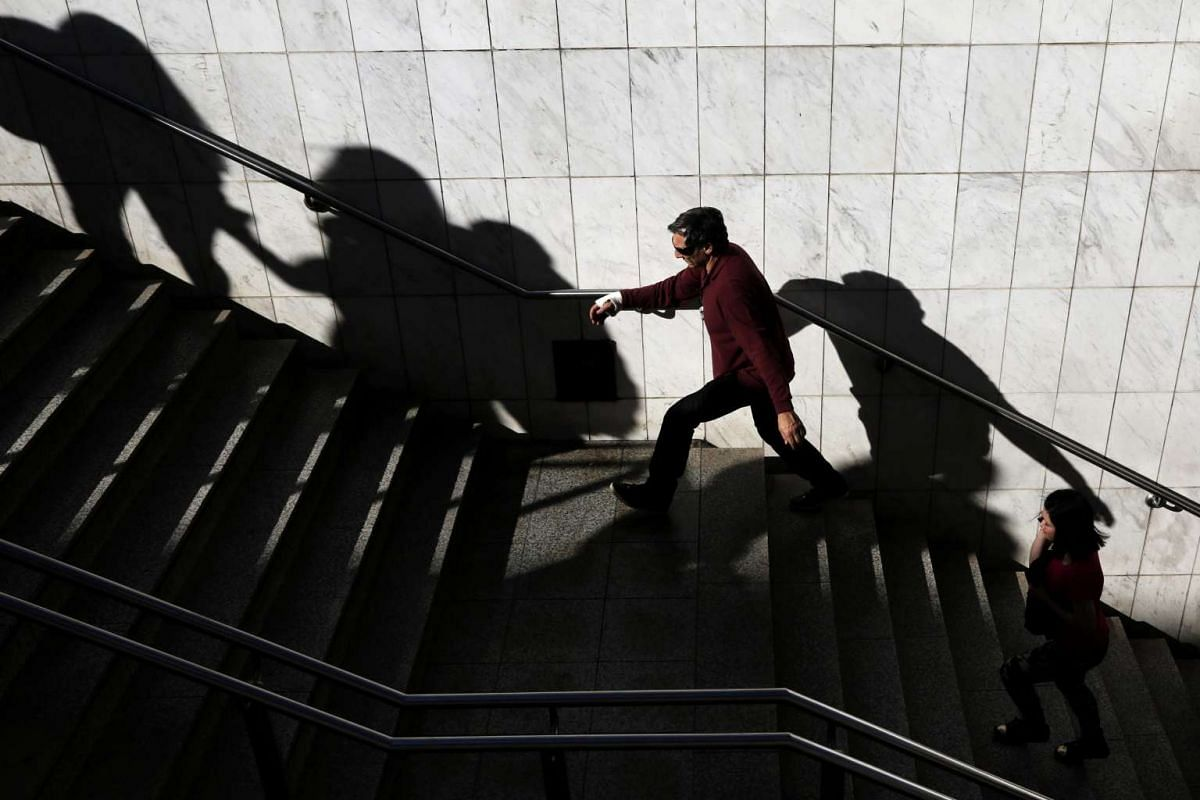 A man leaves a metro station in central Athens, Greece.