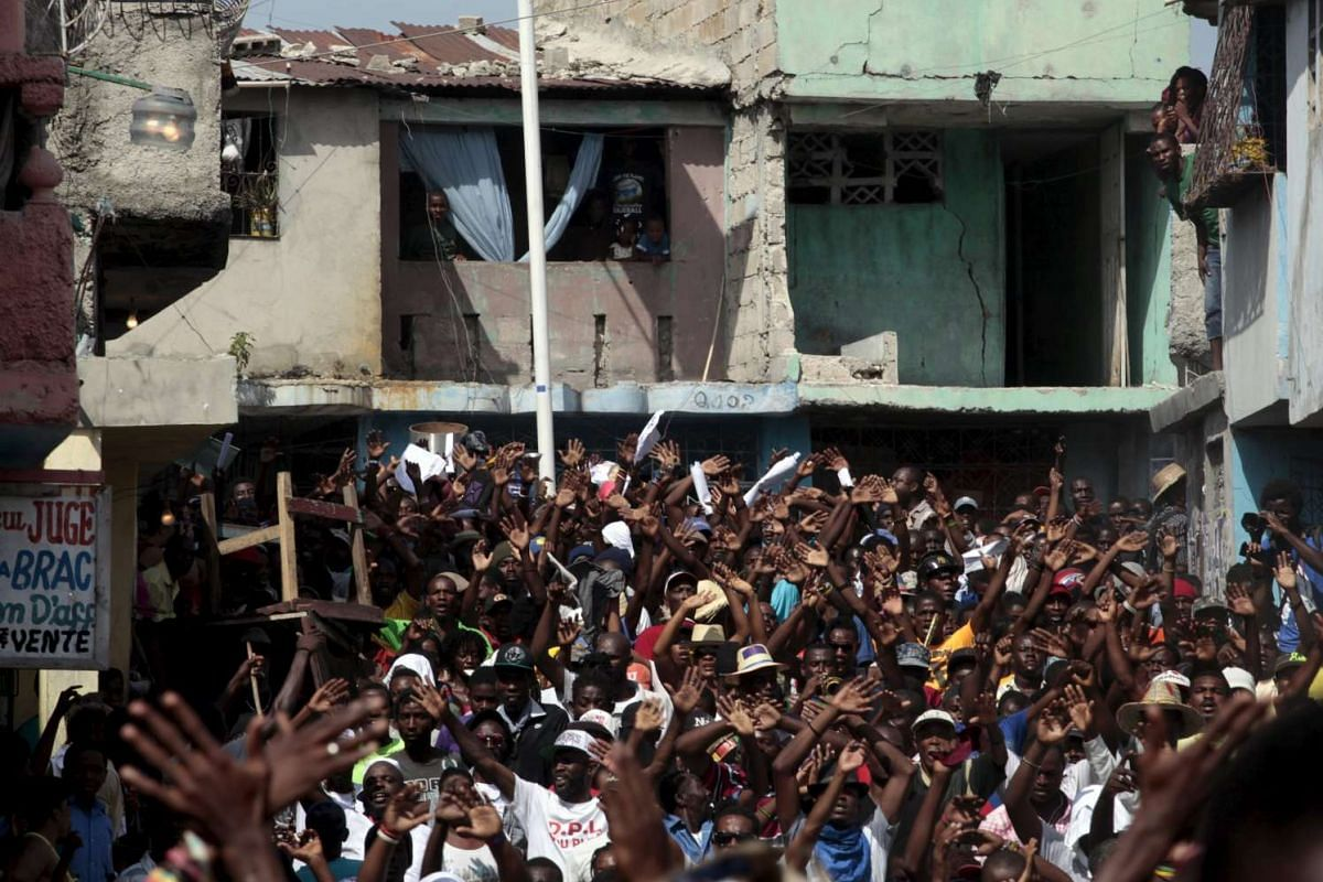 Protestors march during a demonstration against the results of the presidential elections released last week in Port-au-Prince, Haiti.