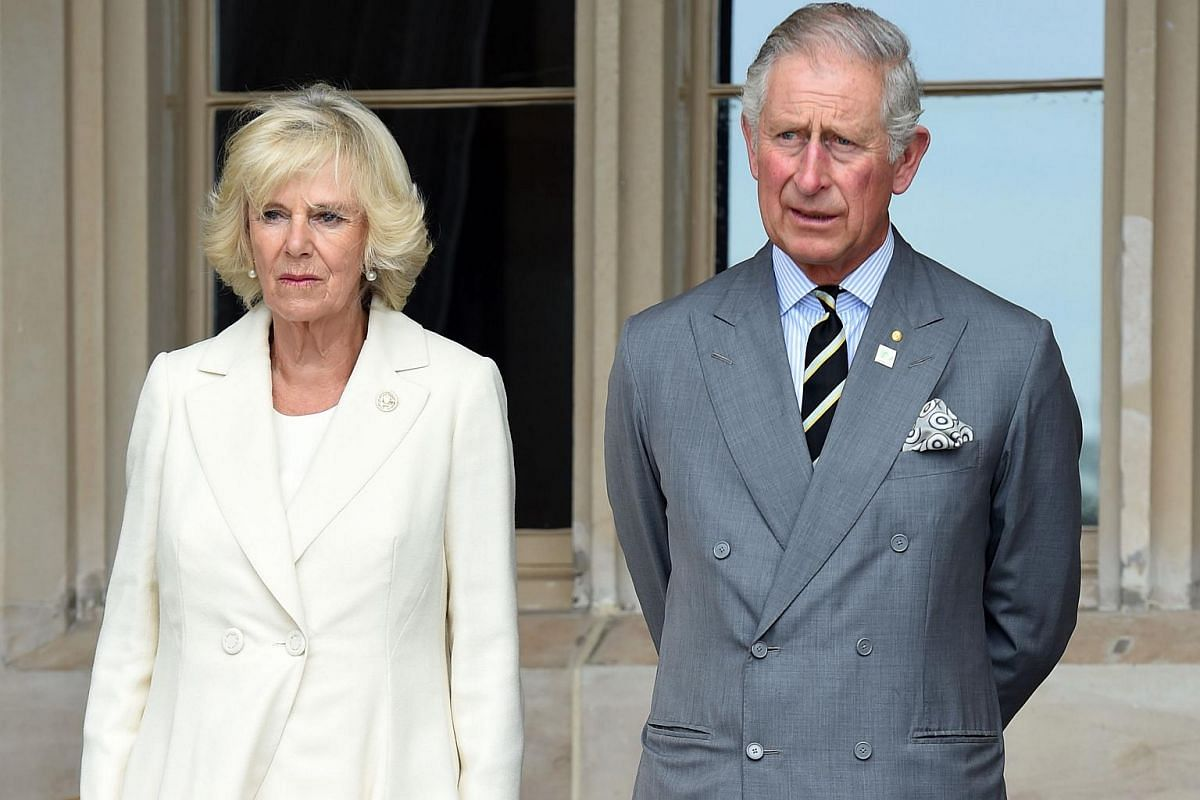 Britain's Prince Charles (right) and his wife, Camilla the Duchess of Cornwall, listen to speeches during a reception at Government House in Sydney, Australia, on Nov 12, 2015.