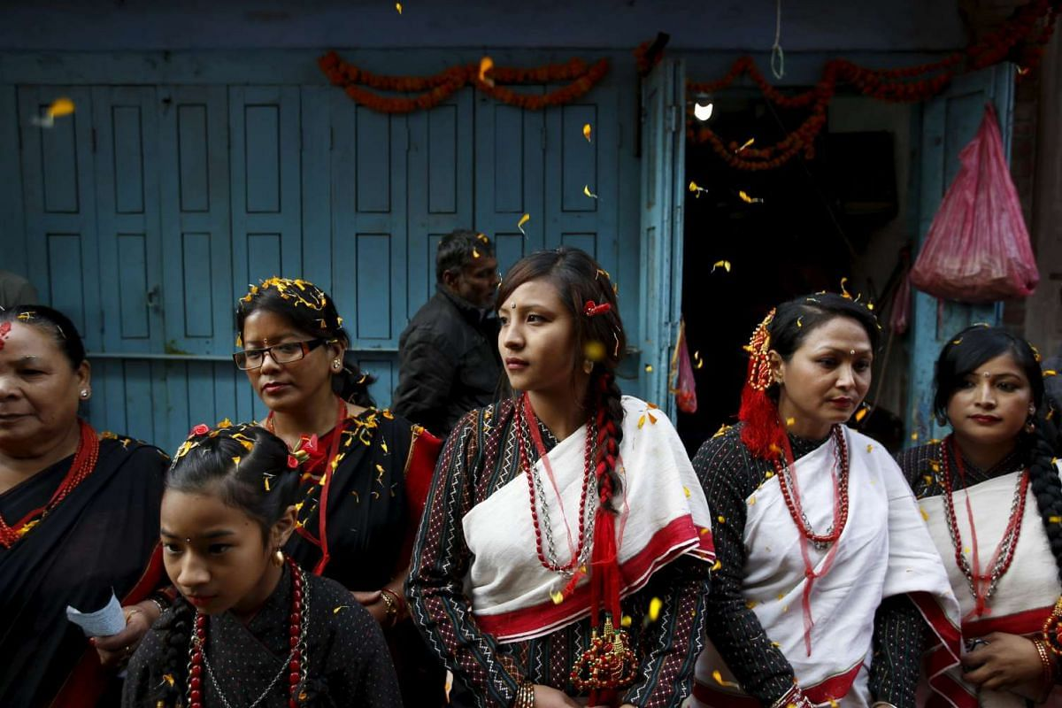 Participants from Newar community in traditional attire, take part in the parade to celebrate Newari New Year that falls during the Tihar festival, also called Diwali, in Kathmandu, Nepal
