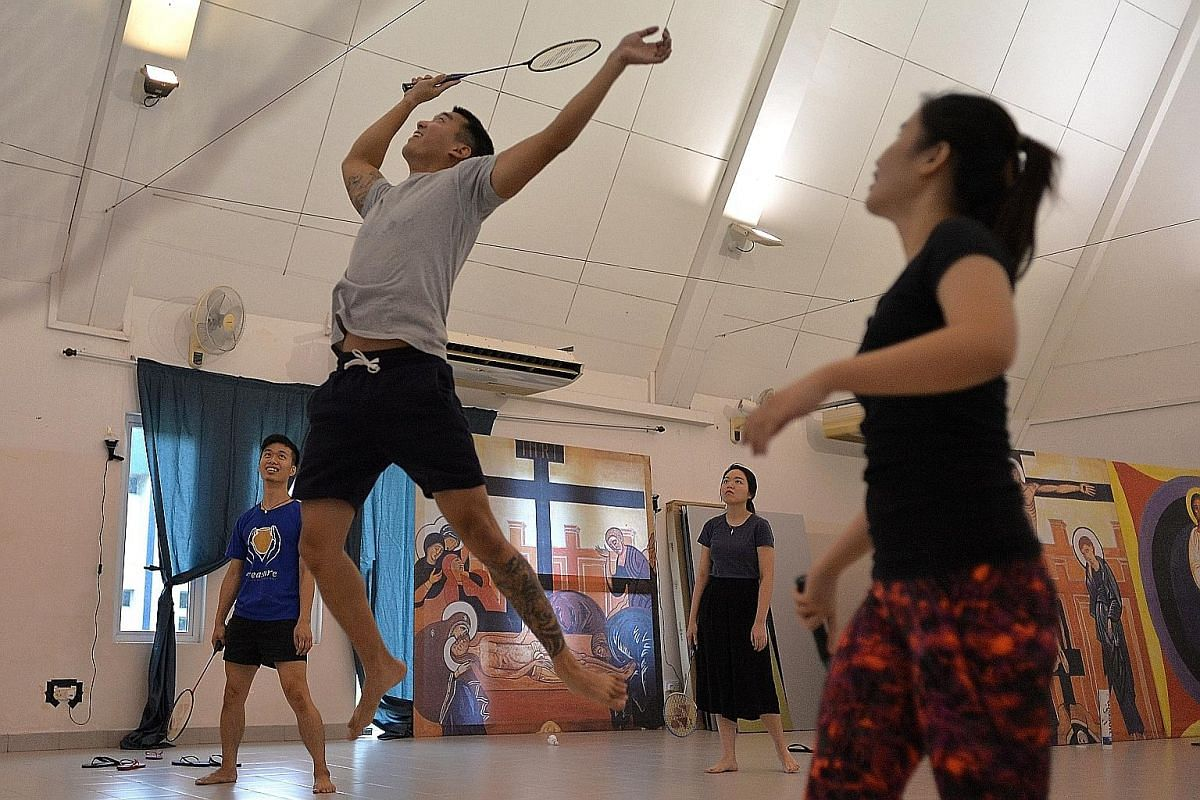 (Above) Mr Ng enjoying a different version of a game of badminton with friends at a church retreat for young Catholic adults over the weekend. Here, they are pitting five players against another five.