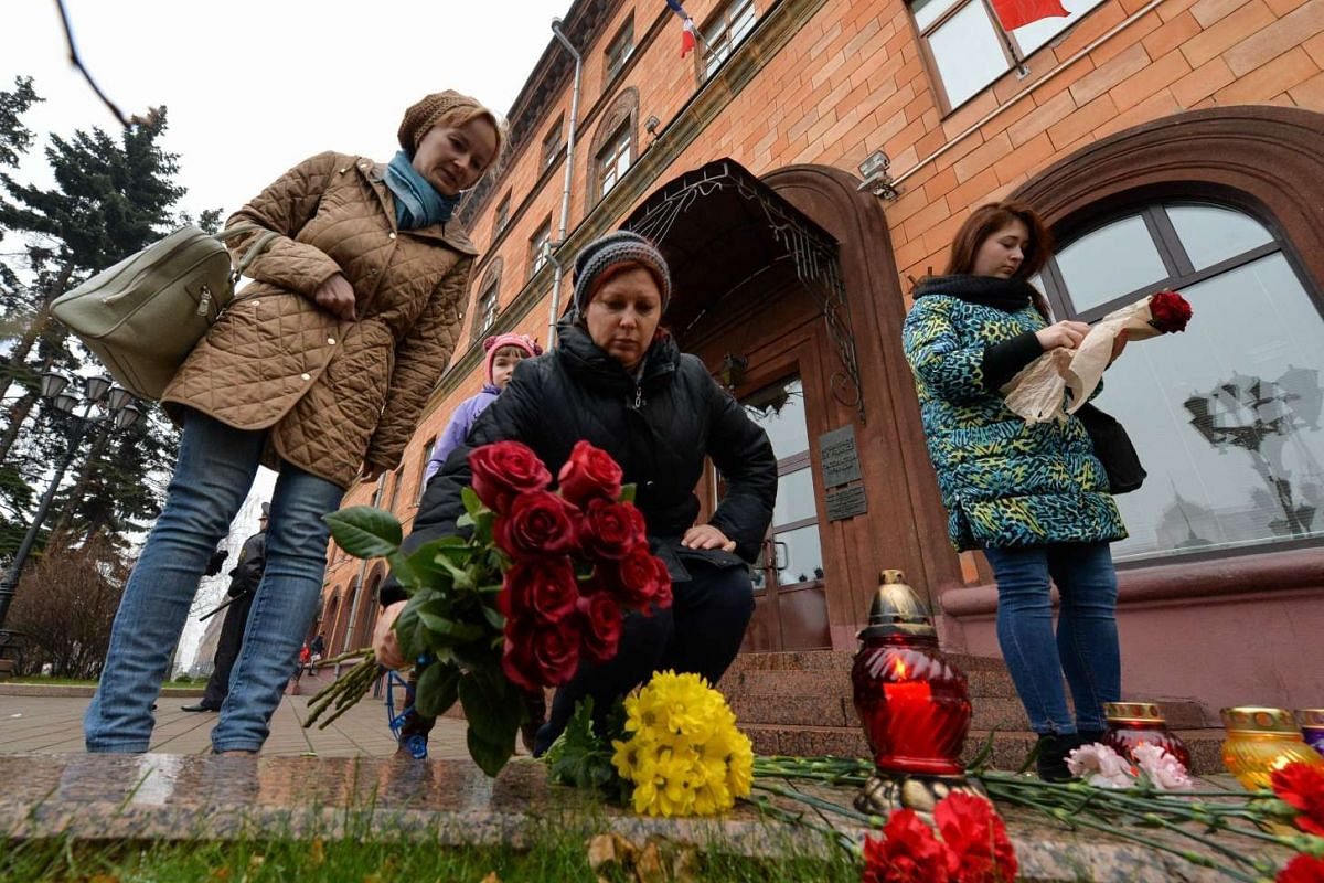 People place flowers outside the French embassy in Minsk.
