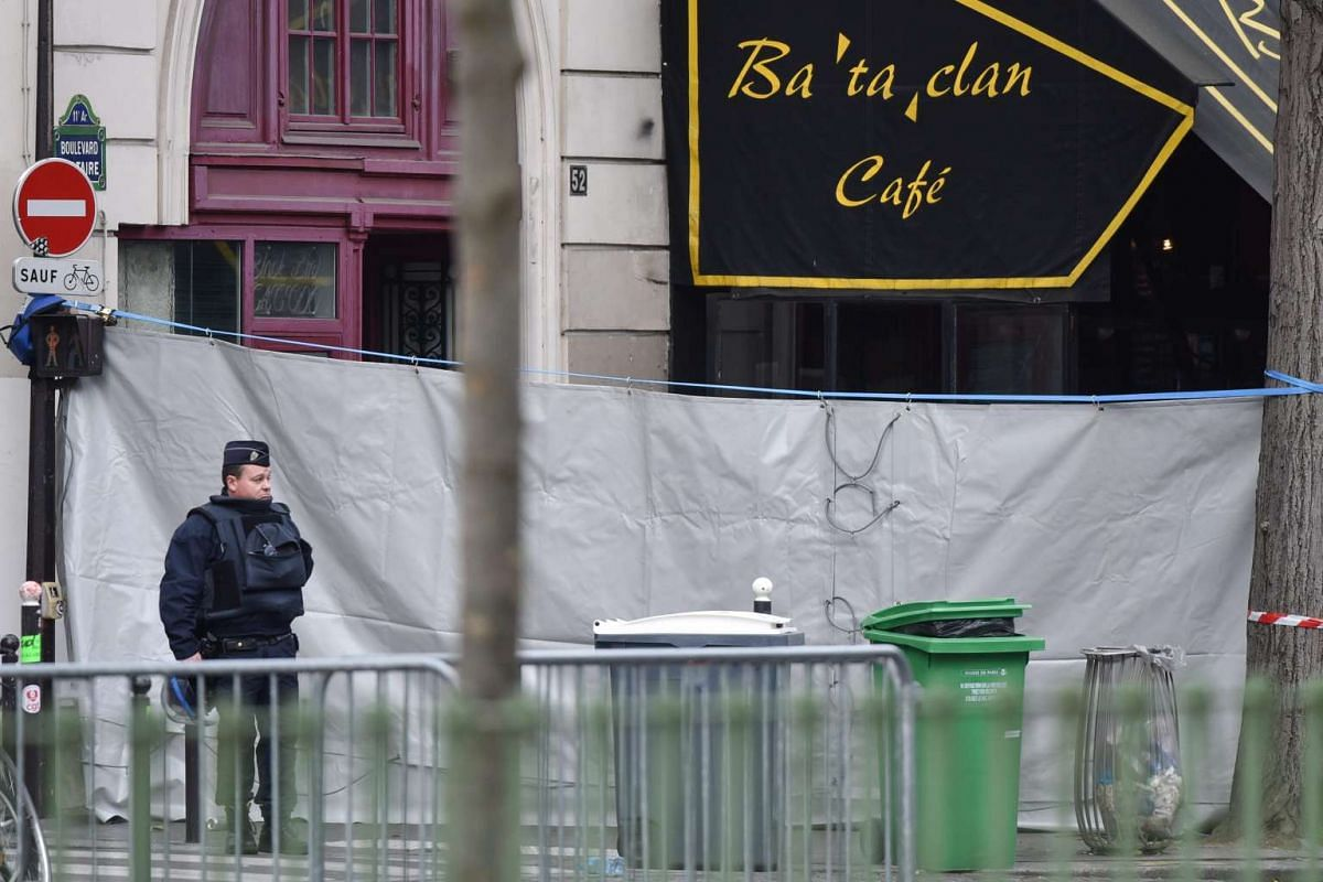 A police men stand guard next to the Bataclan concert venue in Paris, France.