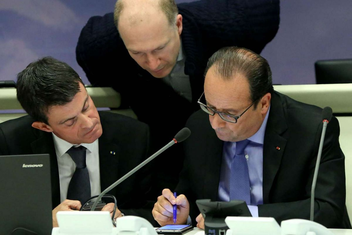 French President Francois Hollande (right) attending an emergency  meeting at the Interior Ministry.