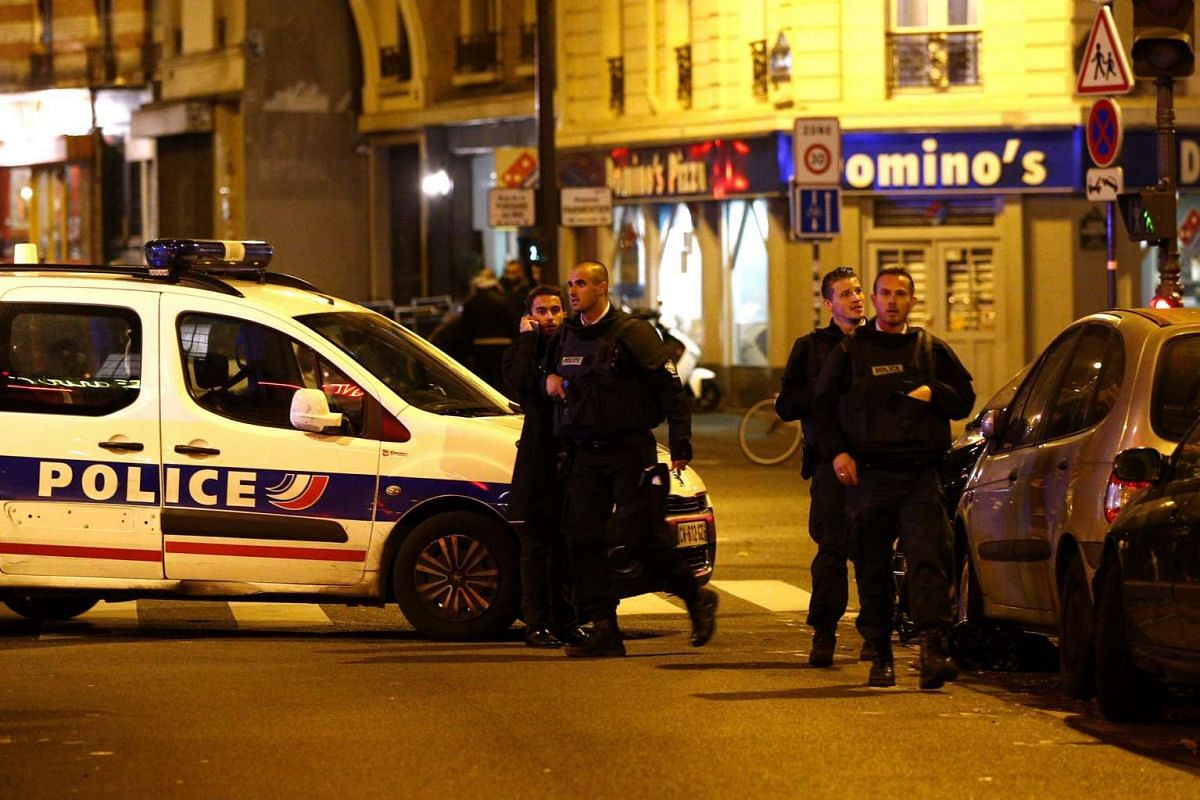 Police officers arriving at the scene of a shooting in a Paris restaurant.