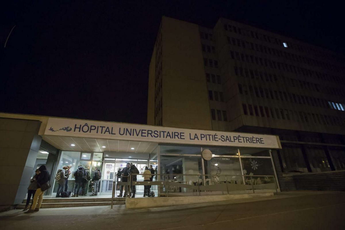 Journalists gathered at the entrance of the Universite La Pitie-Salpetriere hospital, where victims of the attacks were sent to.