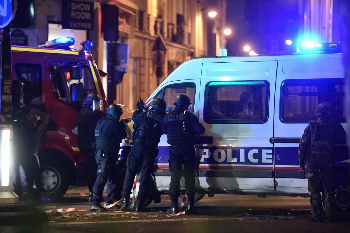 Police officers gathered outside the Bataclan concert hall, where gunmen took people hostage.