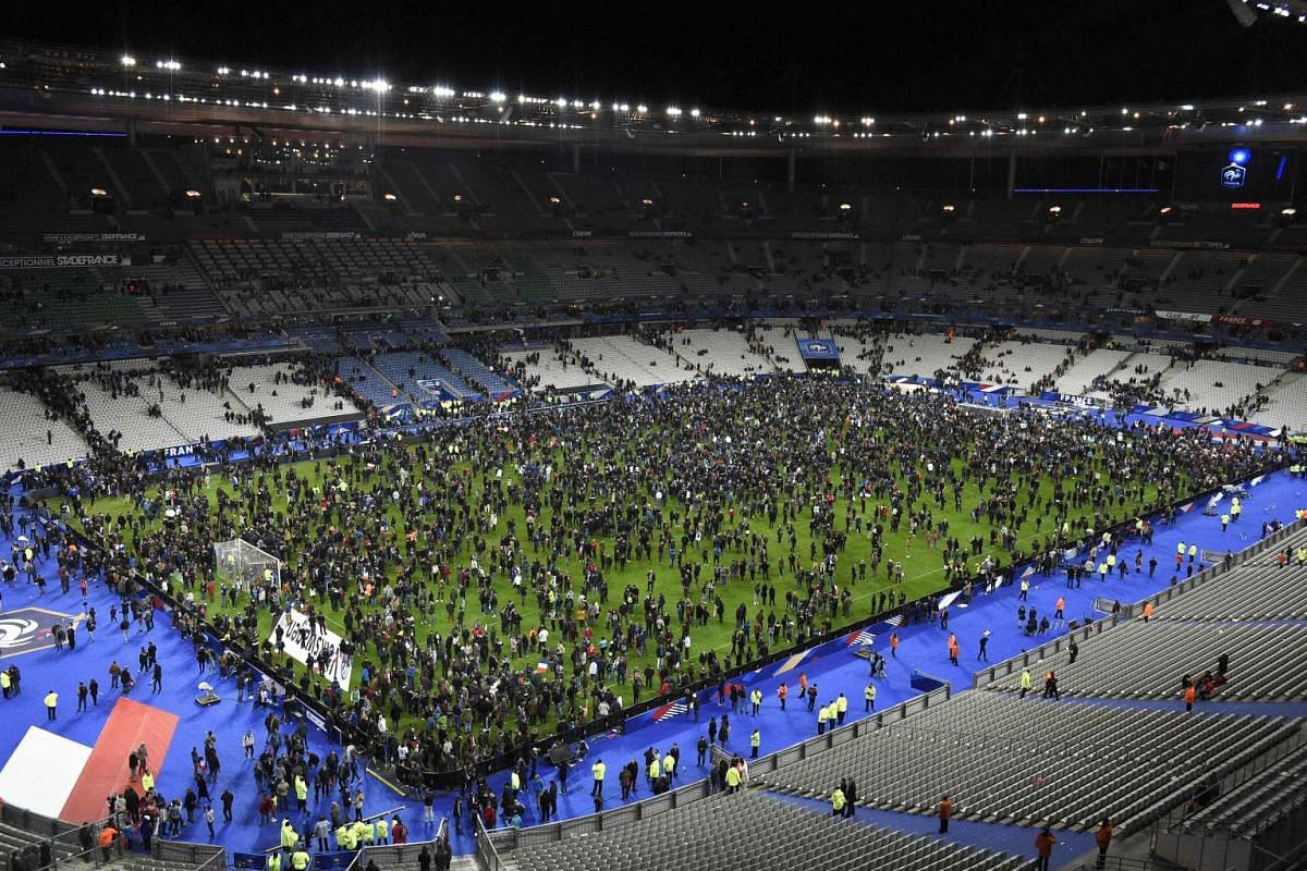 Spectators gathering on the Stade de France pitch after the friendly football match between France and Germany.