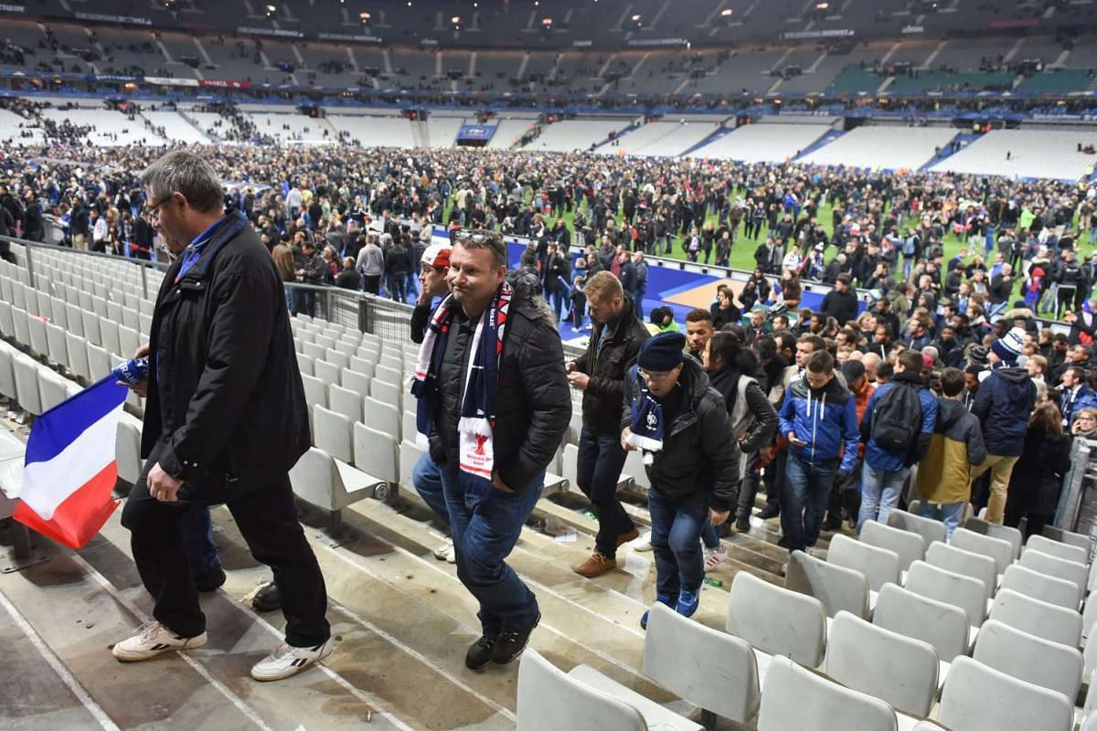 Spectators leaving the Stade de France after the football match.