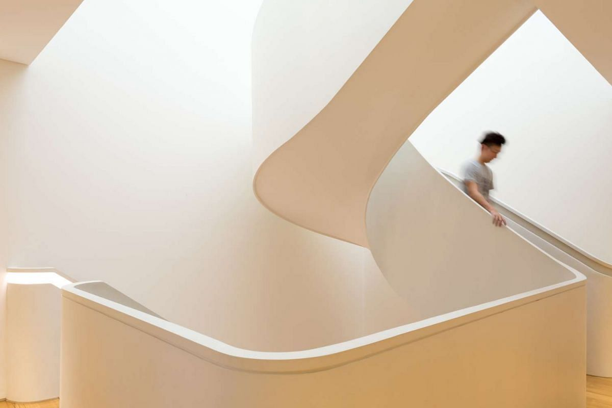 The curvy statement staircase (above) links the different floors; and the living room.