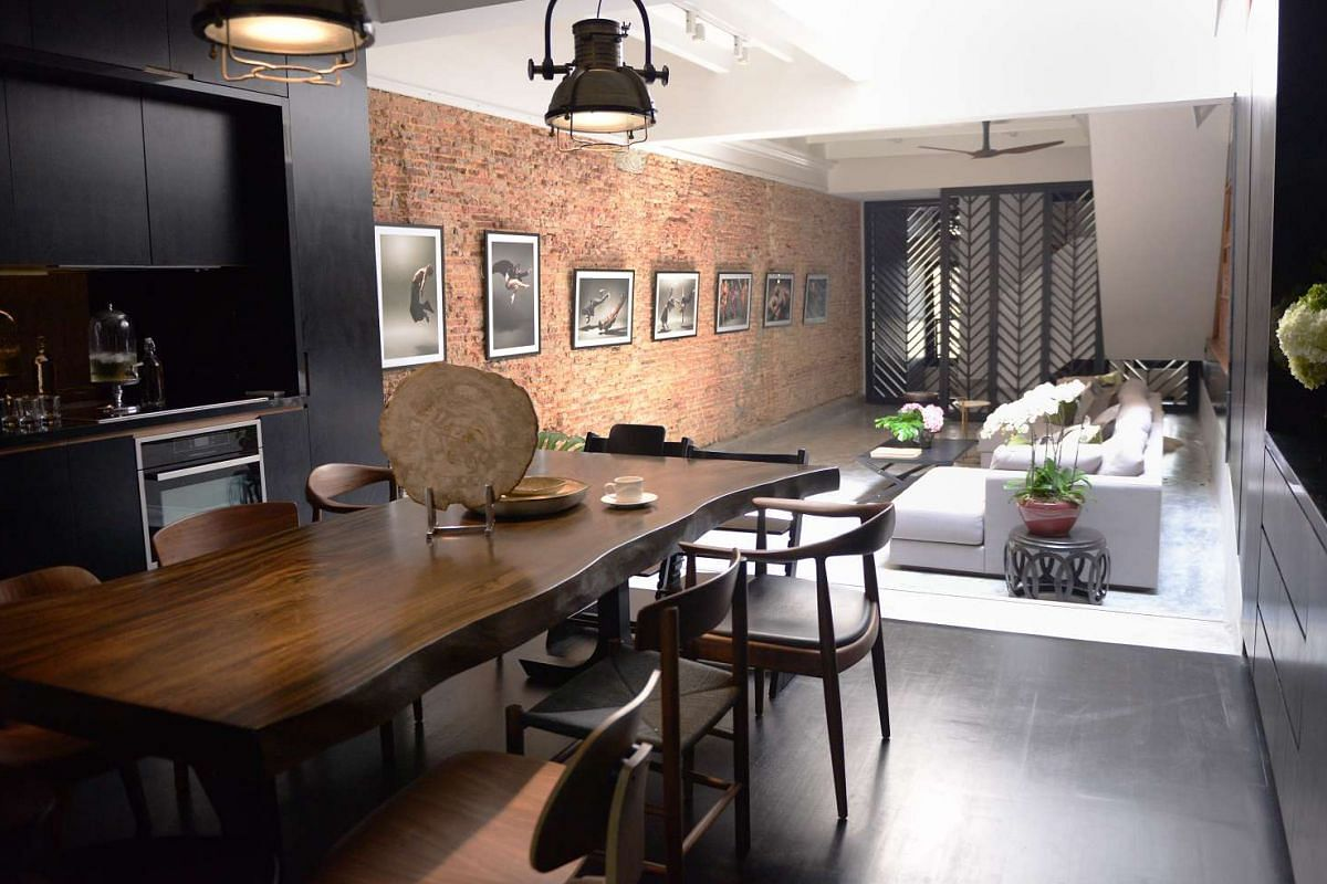 Owners Jaelle Ang and Yian Huang in his home office; the hang-out area outside their Emerald Hill shophouse; and the dining area adjoining the living room (above).
