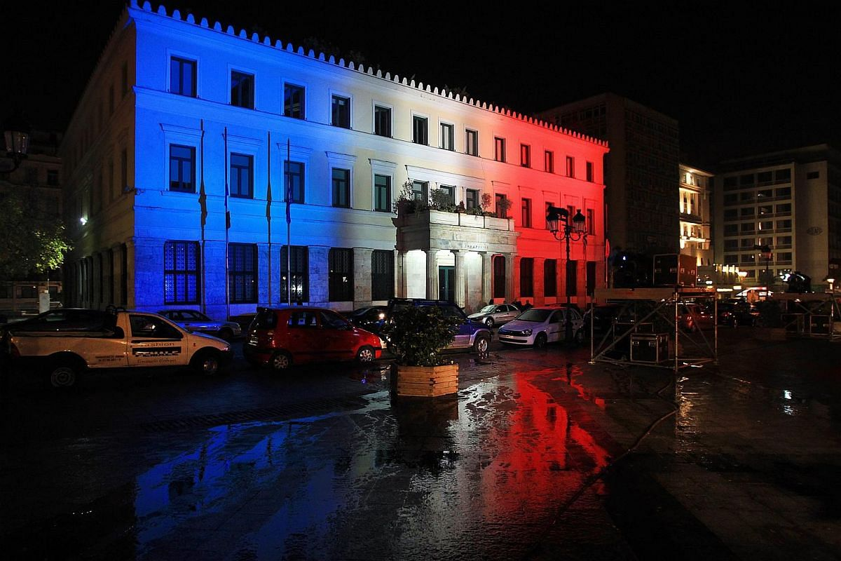 The colours of the French flag are reflected on the town hall building of Athens, Greece.