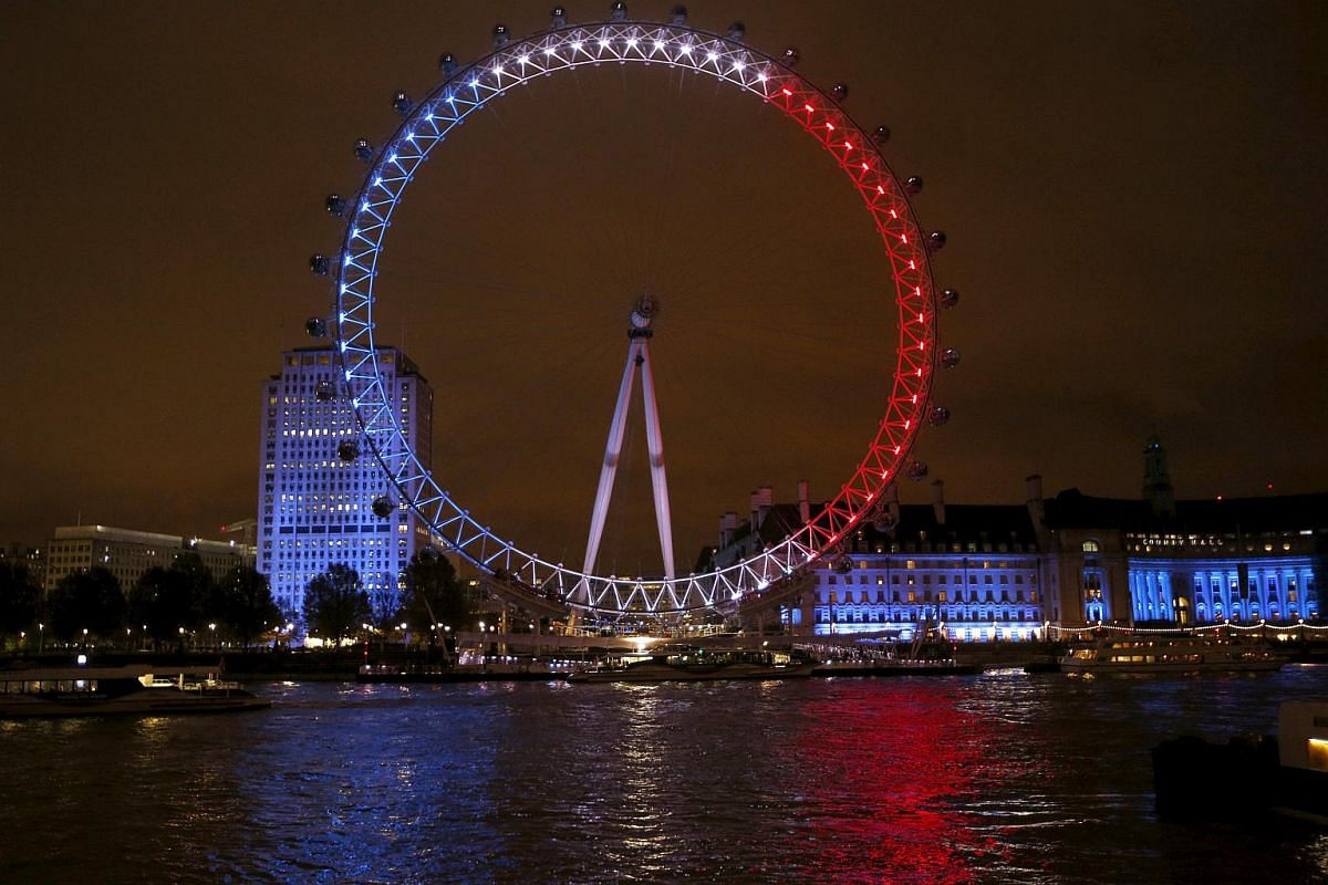 The blue, white and red colours of the French national flag light up the London Eye ferris wheel in tribute to the victims of the Paris attacks.
