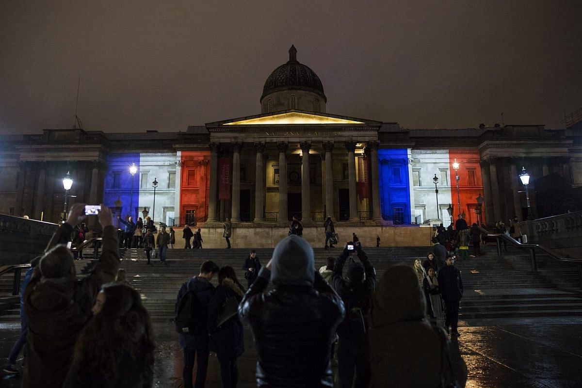 The National Gallery in Trafalgar Square, Britain is lit in the colours of the French flag.