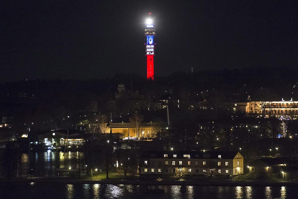 Swedish TV signal tower Kaknastornet is illuminated in the French national colours.