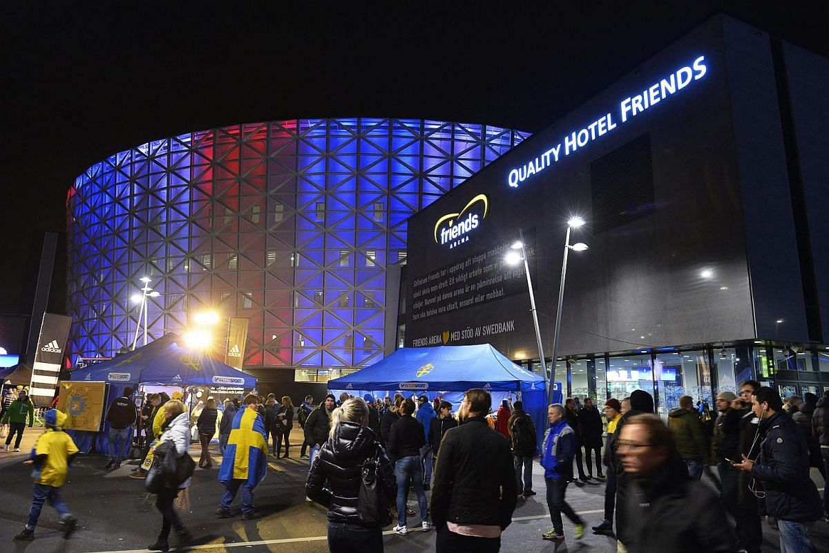 The Friends Arena is illuminated in the French national colours outside Stockholm, Sweden before the Uefa Euro 2016 qualification playoff football match between Sweden and Denmark.