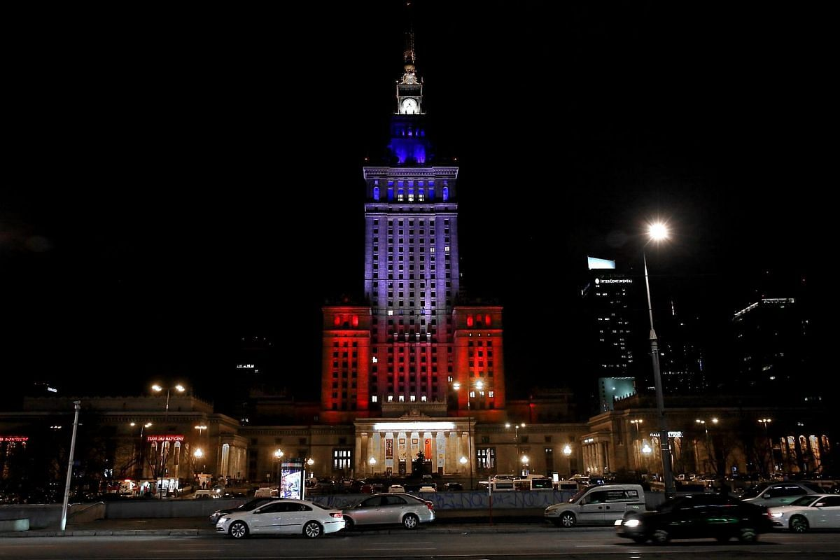 The Palace of Culture and Science is illuminated in the French national colours in Warsaw, Poland.