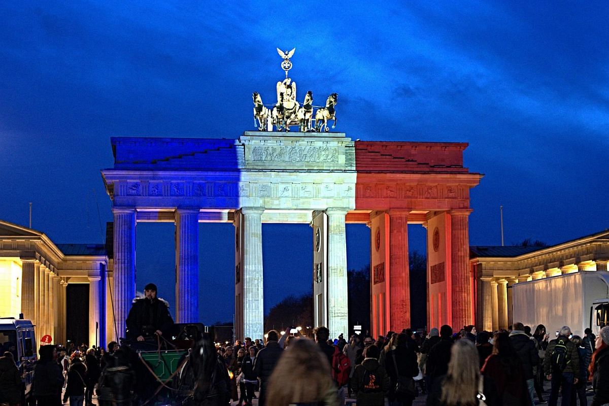 The Brandenburg Gate is illuminated in the French national colours in Berlin, Germany on Nov 14, 2015.