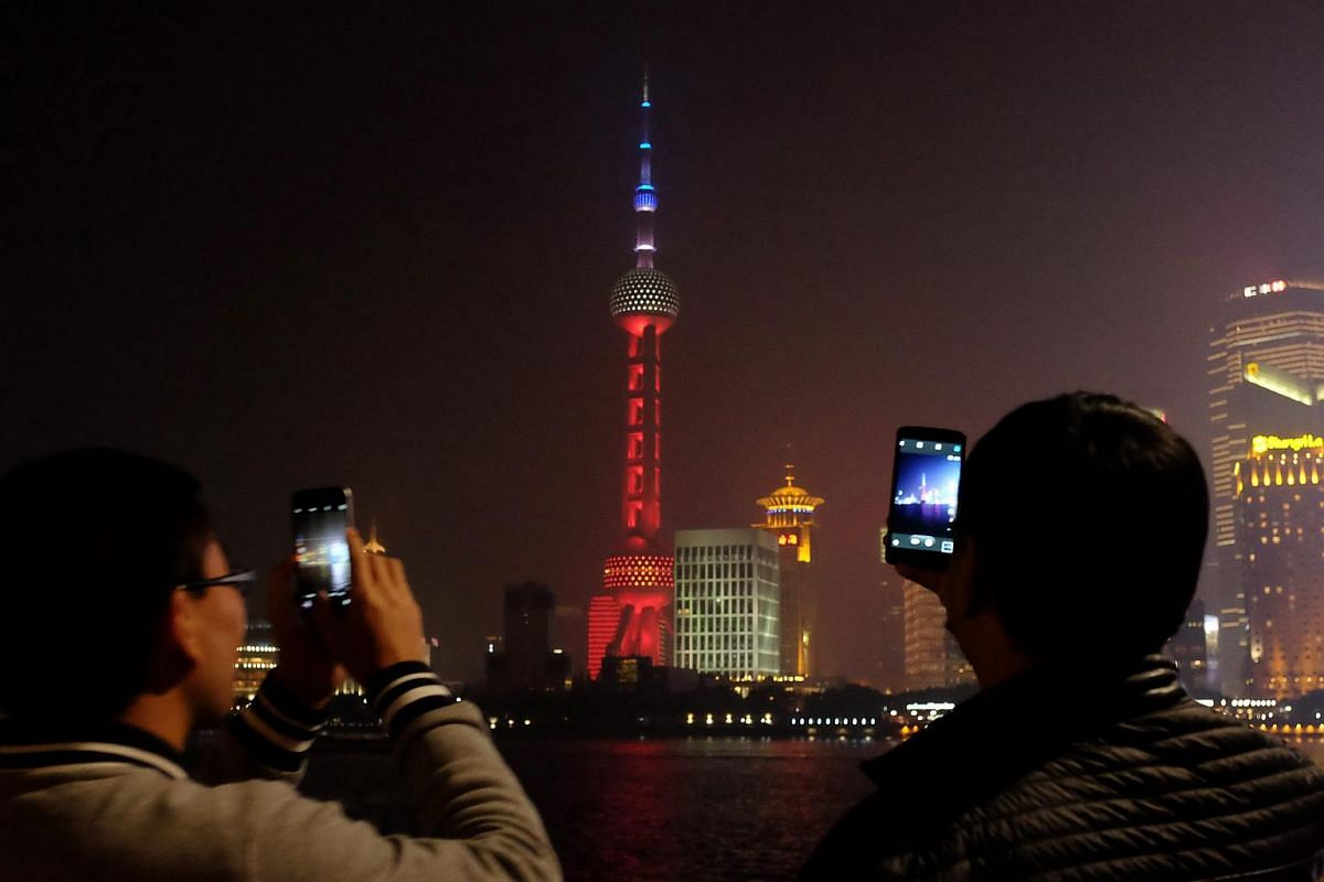 Shanghai's landmark Oriental Pearl Tower is seen lit up in the French national colour in Shanghai, China.