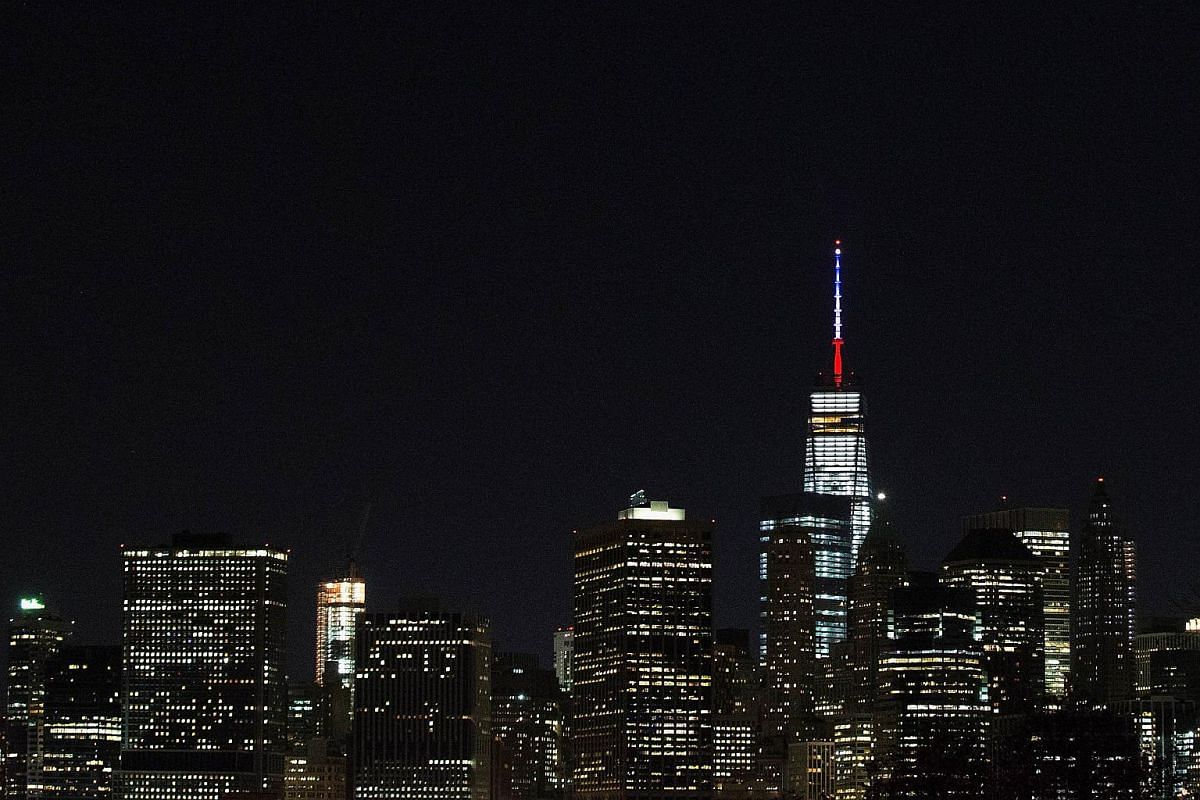 One World Trade Centre's spire is shown lit in French flags colors in New York City.