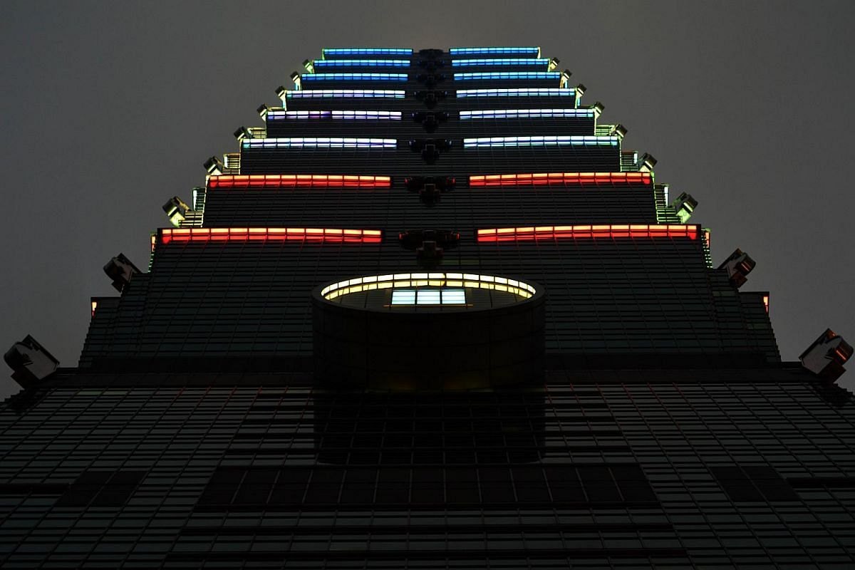 Lights are lit with the colours of the French flag on the Taipei 101 building in Taipei.