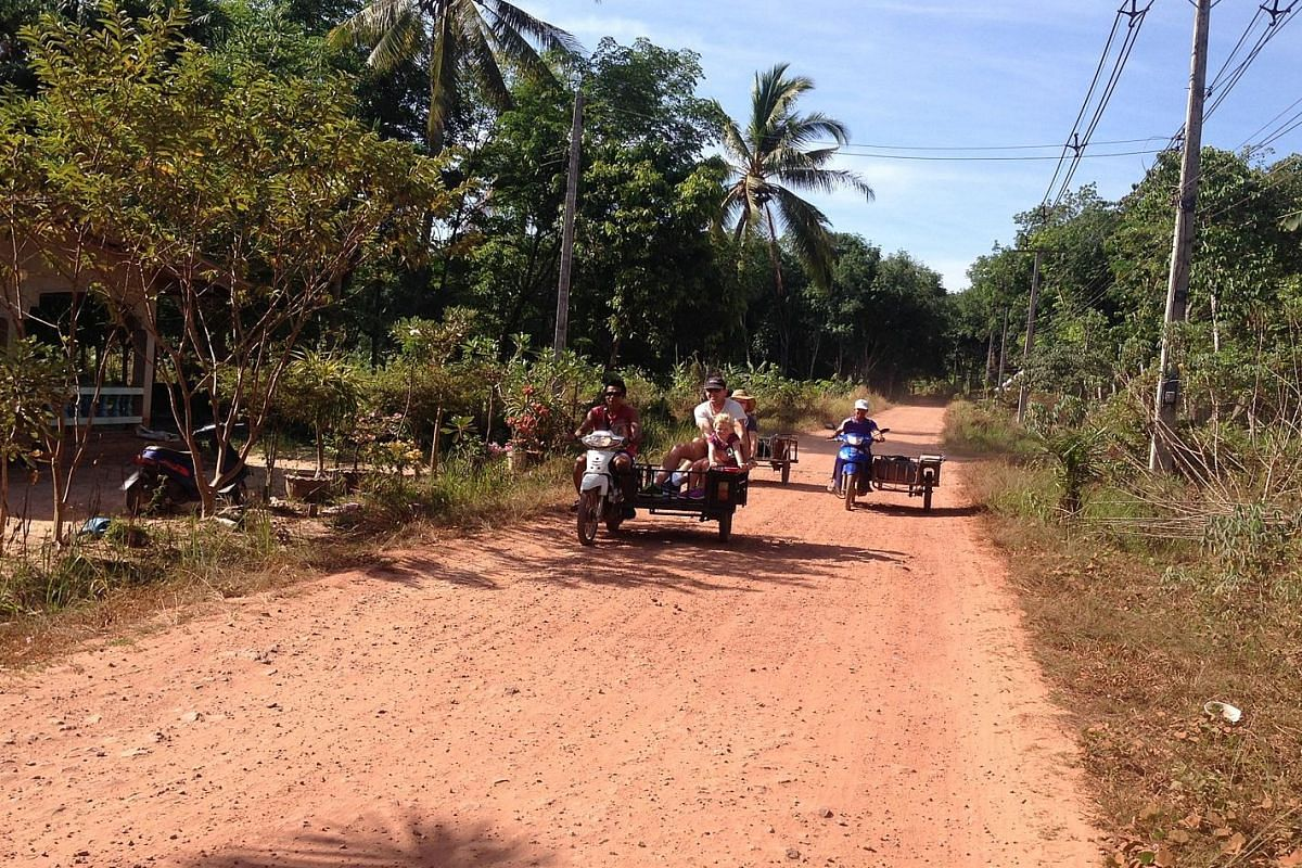 Motorcycle sidecar taxis ply the roads on Koh Jum.
