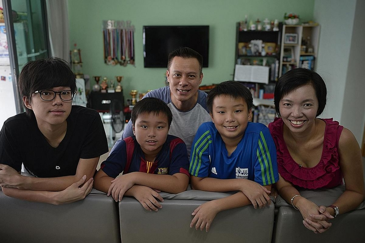 Mr Alan Lin and Ms Ariel Ko (both above), with their sons Kai Xiang (left) and Hong Wei (right), have insurance policies that include coverage for education and hospitalisation. Mr Rohith Murthy has bought health insurance for his baby daughter Radha