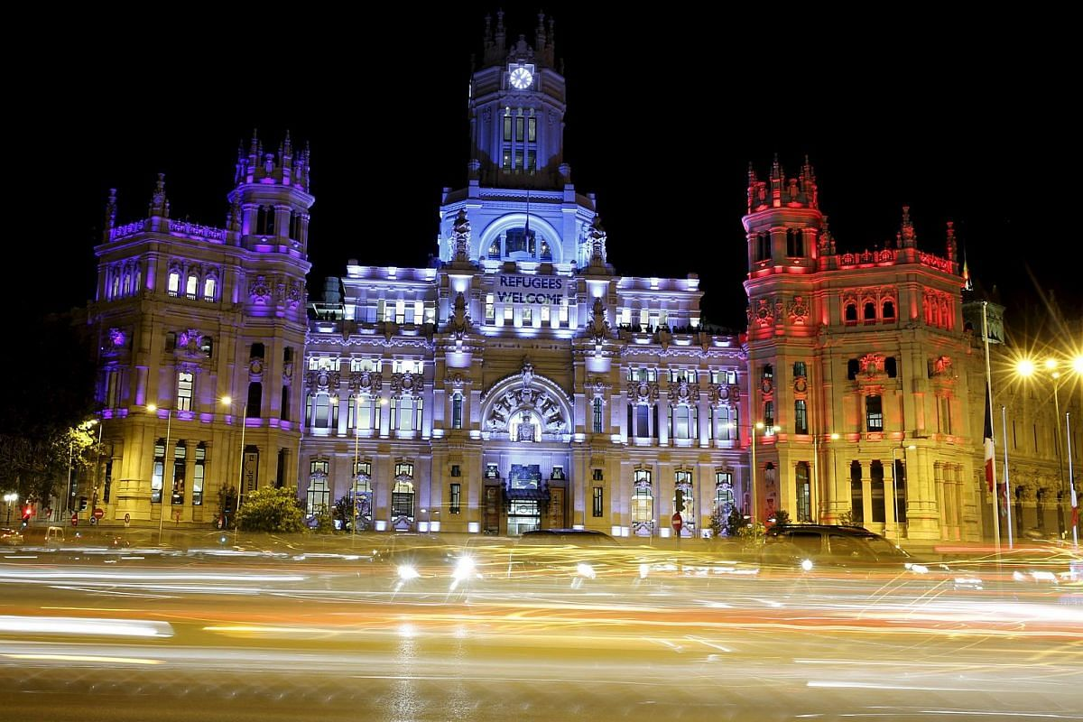 Madrid's Town Hall illuminated with the colours of French national flag in Madrid, Spain.