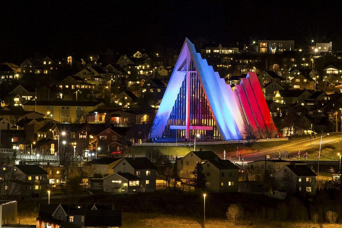 The Arctic Cathedral illuminated in the French national colours in Tromso, Norway.