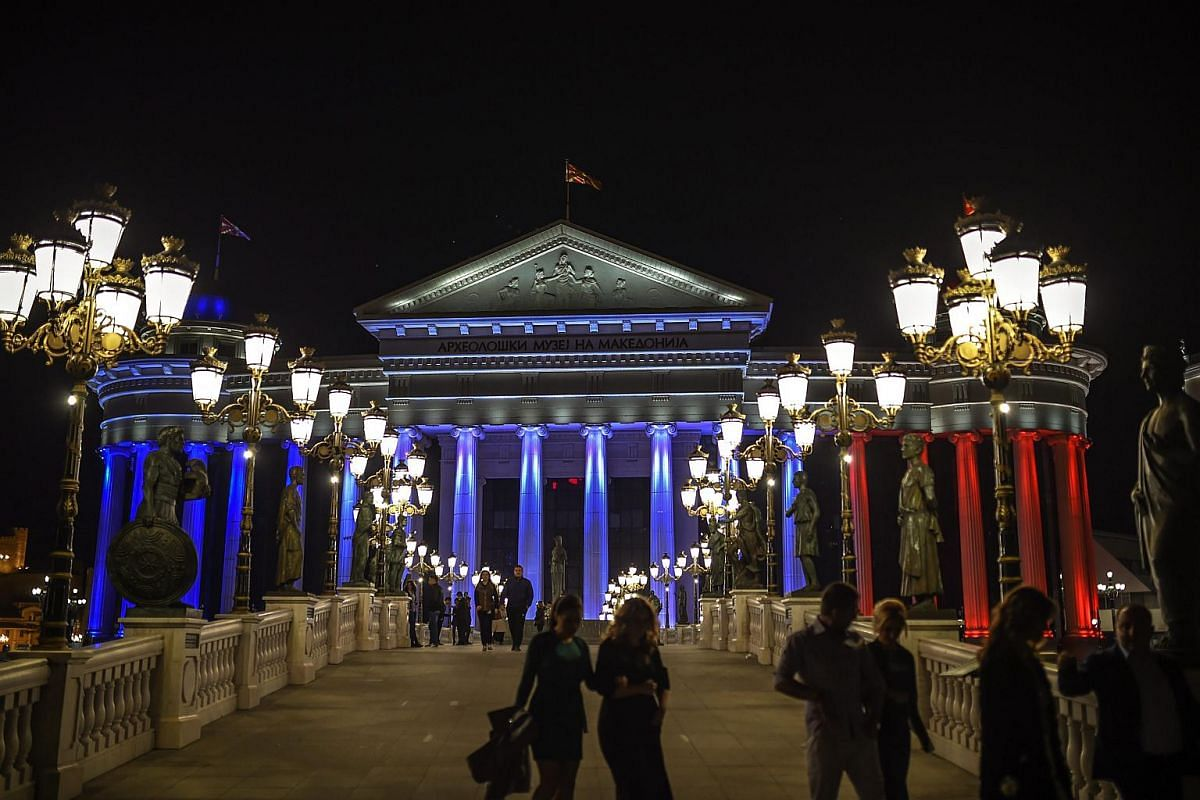 Museum of Archeology of Macedonia and Constitutional Court illuminated in the French national colours in Skopje, The Former Yugoslav Republic of Macedonia.