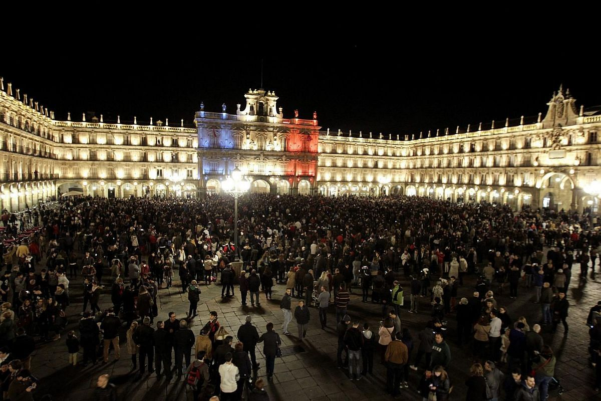 Main square of Salamanca lit in the colours of the French national flag in Salamanca, Castile and Leon, Spain.