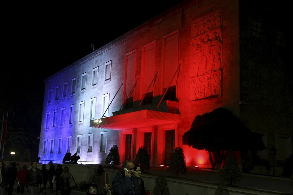 Colours of France's national flag projected at the Government building in Tirana, Albania.