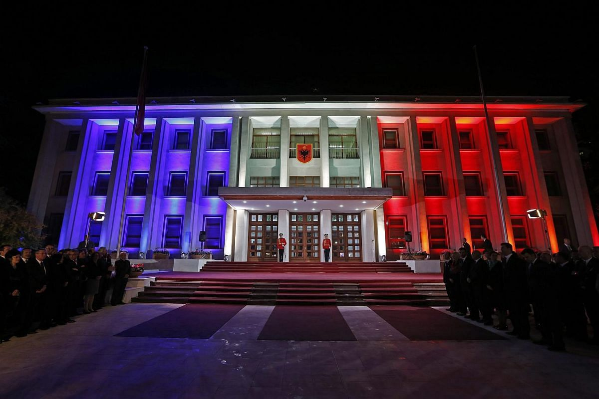 The Albanian President's building illuminated in the French national colours in Tirana, Albania, on Nov 15, 2015.