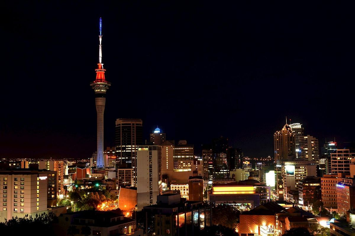 Auckland's Sky Tower lit in the blue, white and red colours of the French flag in Auckland, New Zealand.