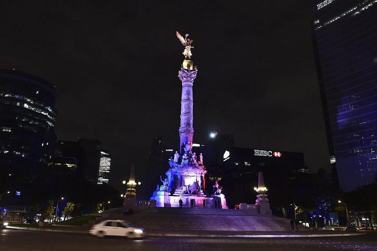 Mexican Independence Angel square illuminated with the colours of the French national flag in Mexico City.