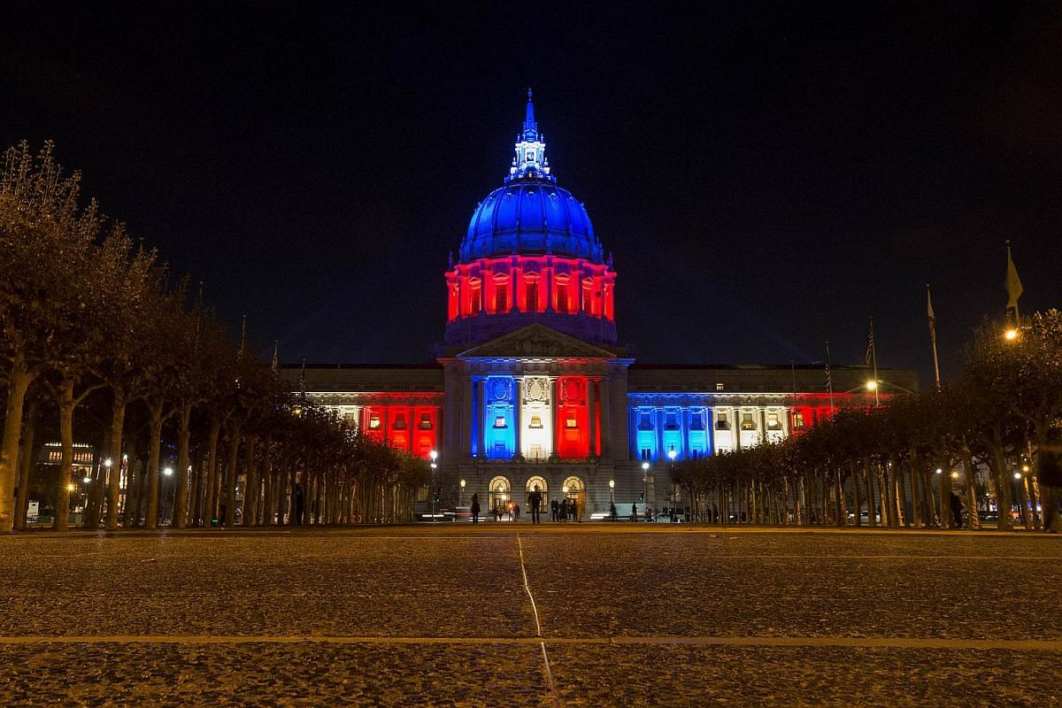 San Francisco's City Hall illuminated in blue, white and red colours of the French national flag in San Francisco, California.