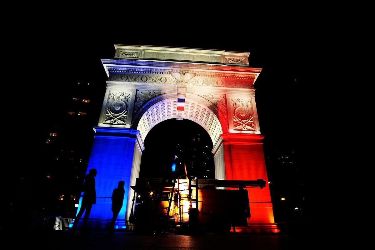 The Washington Square Park arch lit with the French national colours in New York.